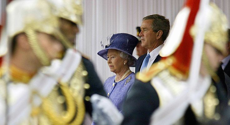 US President George W. Bush (RIGHT) stands with Queen Elizabeth II (LEFT) watch a rewiew of of the Household Cavalry during the full State arrival ceremony on the Forecourt of Buckingham Palace 19 November, 2003 in London, England. Bush is visiting London on a four-day state visit and is expected to be met by some 100,000 people protesting the US lead invasion of Iraq . AFP PHOTO / TIM SLOAN (Photo credit should read TIM SLOAN/AFP/Getty Images)