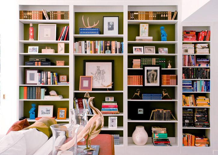 built in bookshelves. full of things.  contrasting color painted in the back.  (not a surprise that I like these, since it actually looks quite a bit like my wall...)  #bookshelves #bookshelf #clutter