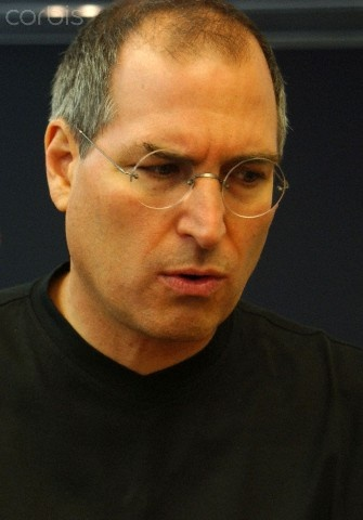 Steve Jobs, co-founder and CEO of Apple speaks with reporters during the opening of Apple SoHo store in New York City on July 17, 2002. Jobs died of complications from his long battle with pancreatic cancer at the age of 56. © Ramin Talaie/Corbis