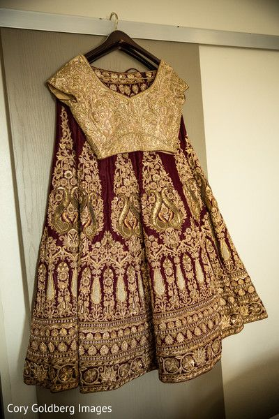 Magnificent golden and red bridal lengha. http://www.maharaniweddings.com/gallery/photo/90198