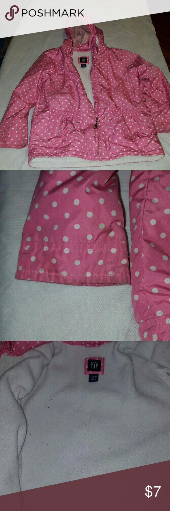 Girls lightweight Baby Gap Hooded Jacket Girls lightweight Baby Gap Jacket, pink with white polka dots.  There is some wear on the cuffs,, can easily be removed with a good scrub and stain remover. GAP Jackets & Coats
