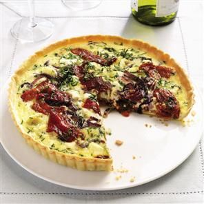 Goat's cheese and red pepper tart recipe. A majestic vegetarian tart recipe that will please all palates with its mix of creamy goat's cheese, sweet peppers and crisp pastry.