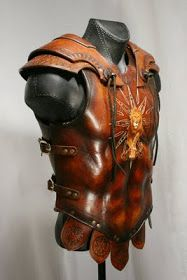 davidpowellart: Leo armor: Based on Roman and Greek styles of armor, this piece is made from 16 oz molded leather, with gold leaf details and bronze buckles.