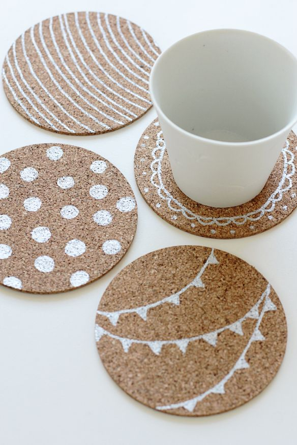 DIY coasters! Super cute and you can use them for decoration too. All you need is:  Cork coasters (Try Amazon.com)  Paint pen (metallic silver is used in the photo here)
