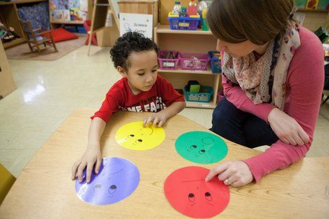 A Trauma Smart therapist talked about feelings with a child at a school in Kansas City, Kan.