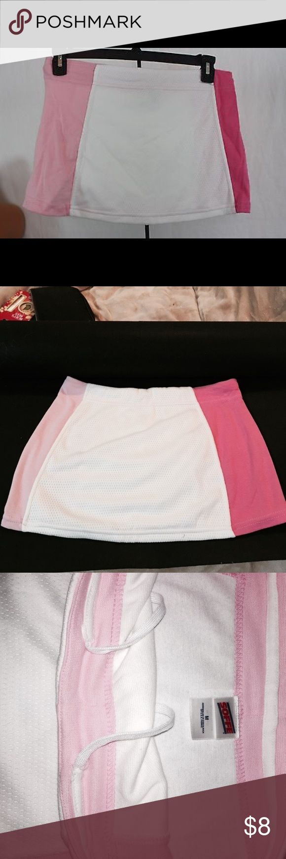 Soffee pink and white athletic skirt New never worn pink and white athletic/ Tennis skirt Size Medium Skirts