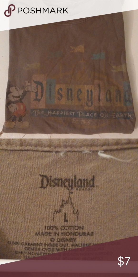 "EUC Disneyland Tee Short Sleeve  Retro Sz L Worn look by design, shirt is used, but excellent condition  Sage green with muted tones  Features Mickey Mouse with the Disneyland logo and slogan, ""The Happiest Place on Earth"" Disney Shirts Tees - Short Sleeve"