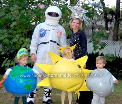 Homemade Outer Space Family Halloween Costume: This is how I made our Homemade Outer Space Family Halloween Costume. I got 3 large 36 inch balloons and paper mached them for the earth, moon and sun.