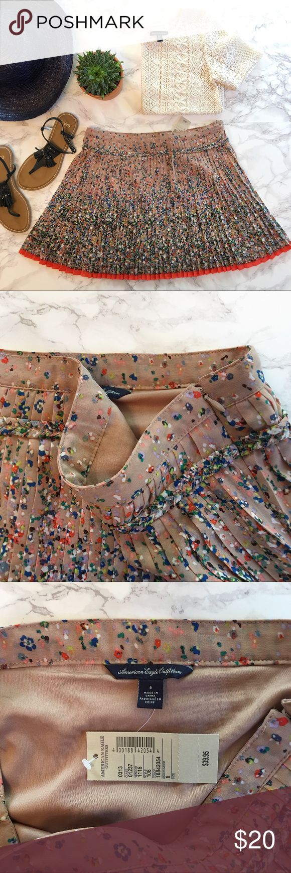 "American Eagle Pleated Skirt Brand new with tags American Eagle Outfitters knife pleated circle skirt. Tiny floral pattern. Fully lined. Side zip ▫️Shell 100% polyester ▫️Lining 100% cotton ▫️Machine be wash and dry ▫️NWT ▫️Pet free/smoke free  Measurements taken flat ▫️Waist 15"" ▫️Length 15""  F.OT.6.17 American Eagle Outfitters Skirts"