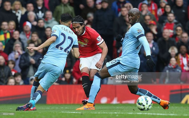 Radamel Falcao of Manchester United in action with Gael Clichy and Fernandinho of Manchester City