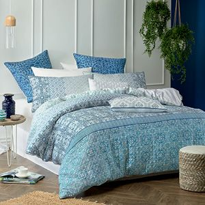 A luxury look in beautiful blues, this quilted and fully piped quilt cover set features stylish, printed panels of decorative mosaics and ornamental motifs. A serene and very elegant design that will provide a striking bedroom statement. The quilt cover has a white reverse with small snowflake print and button closure.