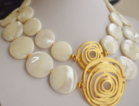 Mother of pearl with gold plated pendant necklace by Lalyca, $210.00