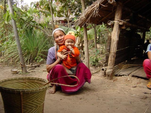 Thailand Karen Hilltribe Village Trip - Grandmother watching the baby