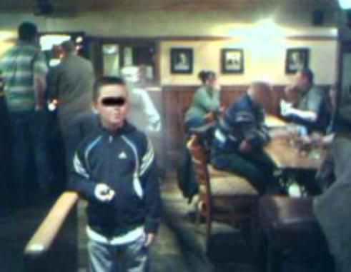 """""""This is a photo taken on a camera phone of a person's son in a bar in Belfast.  The person saw the strange  thing behind his son in the picture, and looked behind him straight away and there was nothing there."""""""