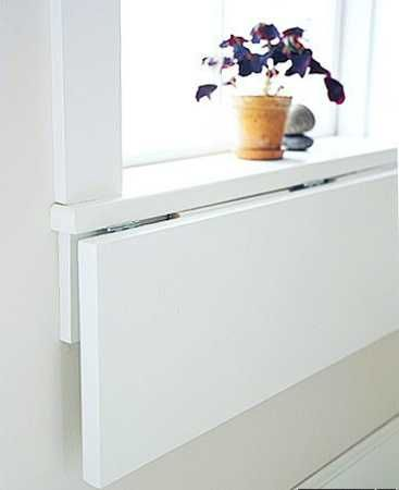 folding table mounted on window sill