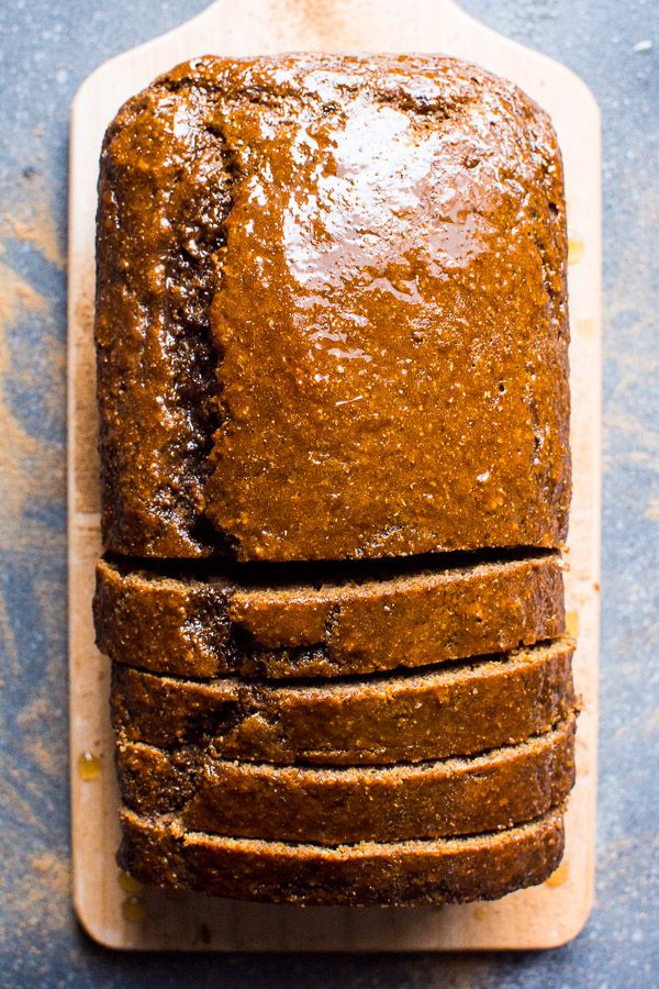 Healthy gingerbread loaf recipe with whole wheat flour, applesauce and simple maple syrup glaze. Fill your kitchen air with holidays spices and enjoy a slice guilt free. Moist and SO good.