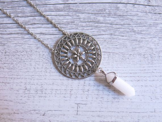 The Divinity necklace features a beautiful mandala design in tibetan silver & white jade drop point.  White Jade is used to direct ones energy