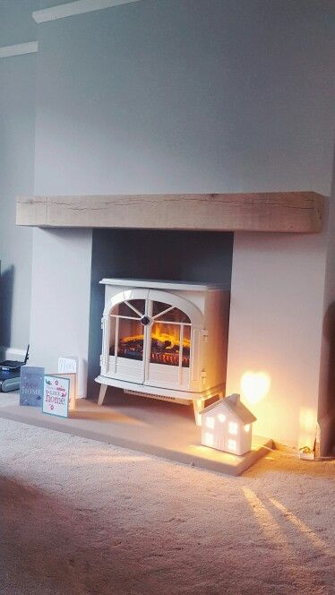 Oak mantel and fire in place  Farrow and ball walls in cornforth white and inside the chimney breast is worster. Picture rail in Wimborne white