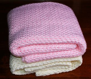 """Fast Easy Crochet Baby Blanket - Free Pattern - This Is A Beginner-friendly Crochet Pattern That's Easy Enough For Anyone To Make. Despite The Skill-level Rating Of """"beginner,"""" I'm Hoping That This Pattern Will Appeal To Crocheters Of Varying Skill Levels; If You Ever Need To Whip Up A New Blanket In A Hurry, This Is A Great Pattern To Have."""