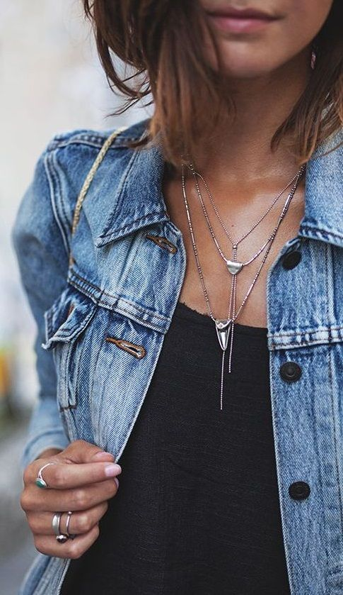 denim jacket. silver layered necklace.