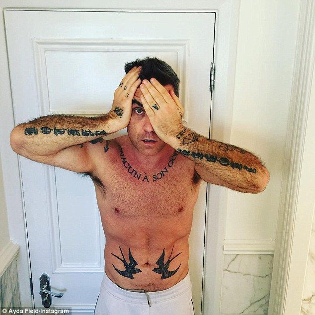 Uncovered: Robbie Williams' wife Ayda Field shared a shirtless shot of the star on Instagram on Wednesday