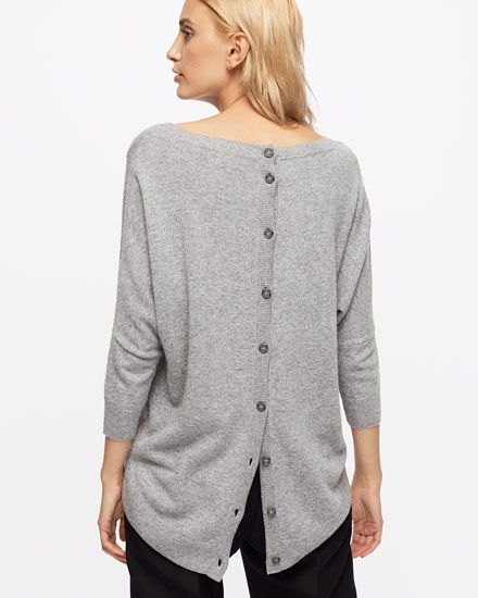 A viscose and lambswool blend with a brush of cashmere has been used to create this simple jumper, making it breathable yet warm. Features include Mother-of-Pearl buttons as a fastening detail down the centreback, a wide round neck, batwing sleeves and a centrefront seam. This is the perfect piece for laidback weekends.