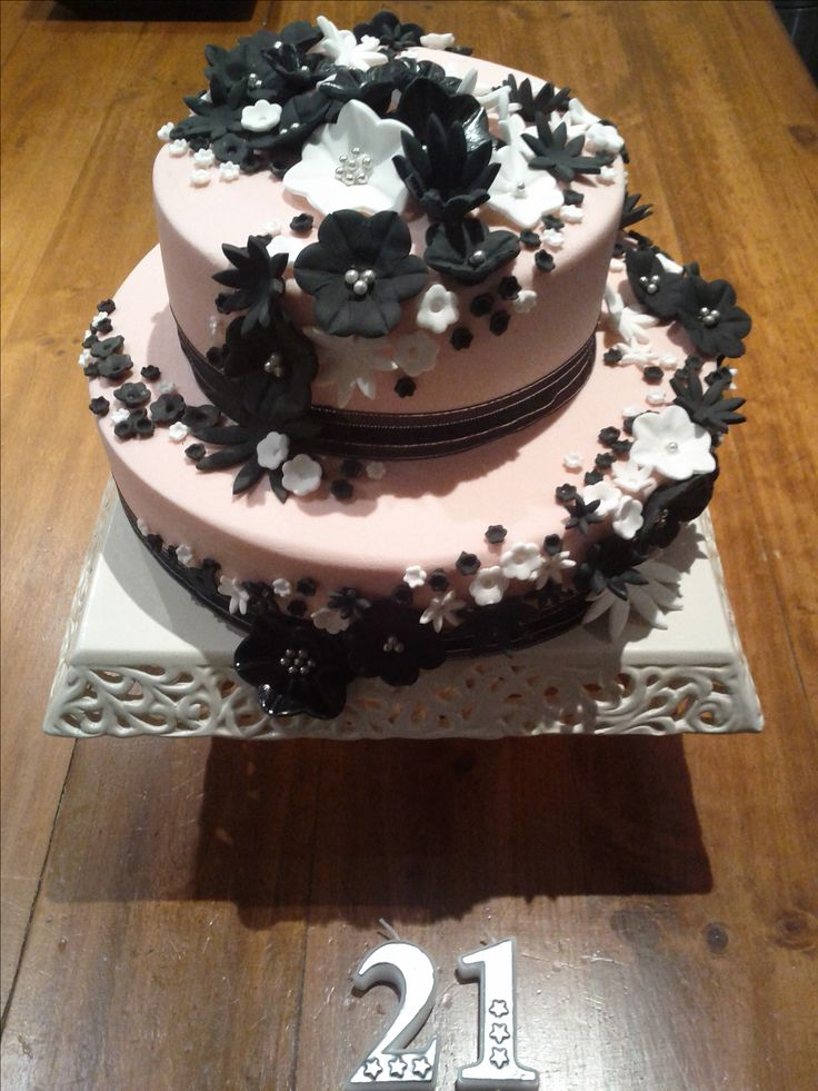 Chocolate mudcake with black and white flowers on pink August 3, 2012