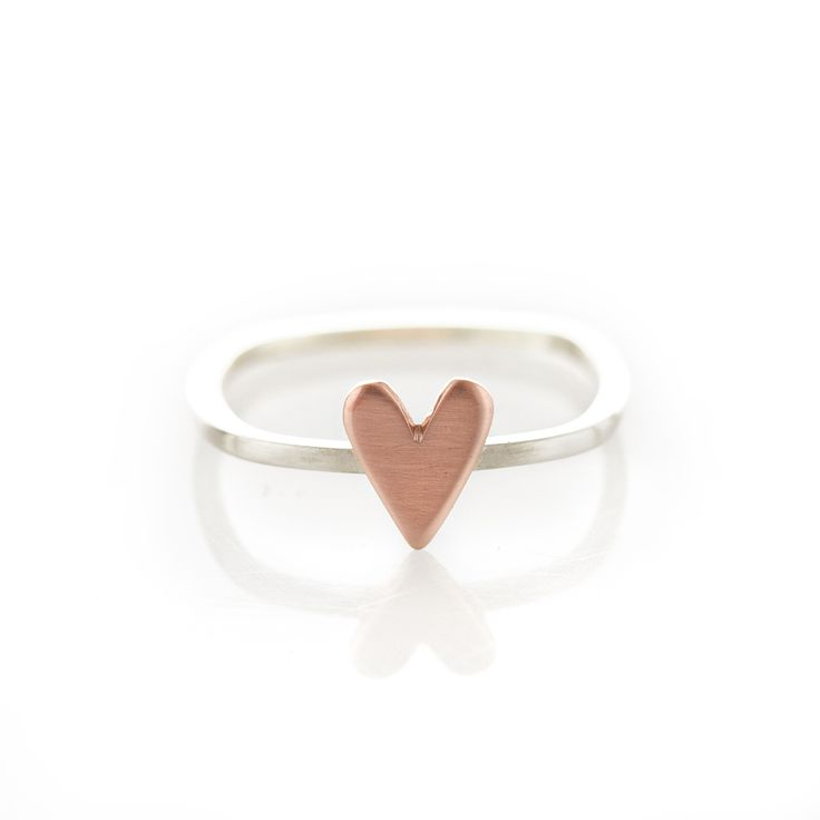 Something Different from Dear Rae   A thin square shaped sterling silver ring with copper heart.  Please check our info page for more details on ring sizes.