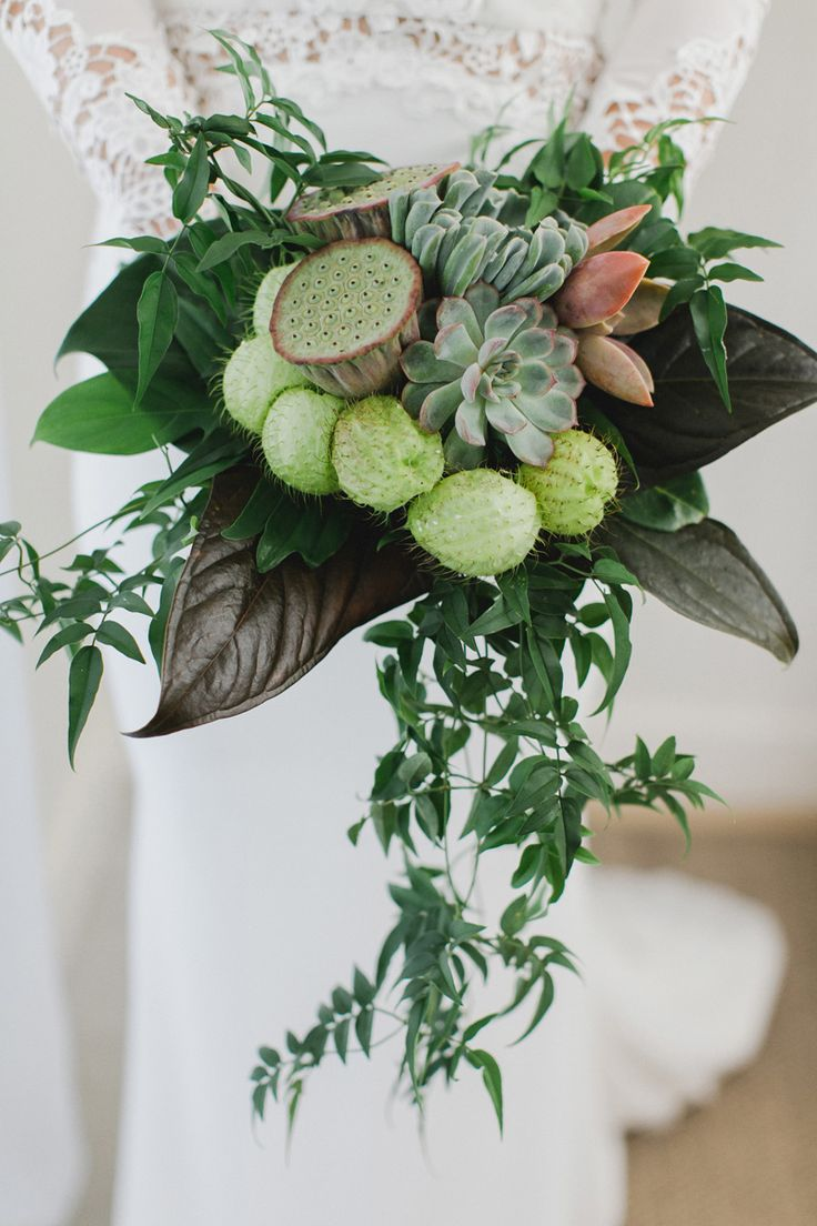 green wedding bouquet with lotus pods, succulents and tropical foliage