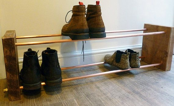 Shoe rack made from copper pipe and reclaimed wood. Measures 100cm X 30cm X 25cm. Custom sizes can be made to order, either longer/shorter or higher with more racks. Message me with your requirements.