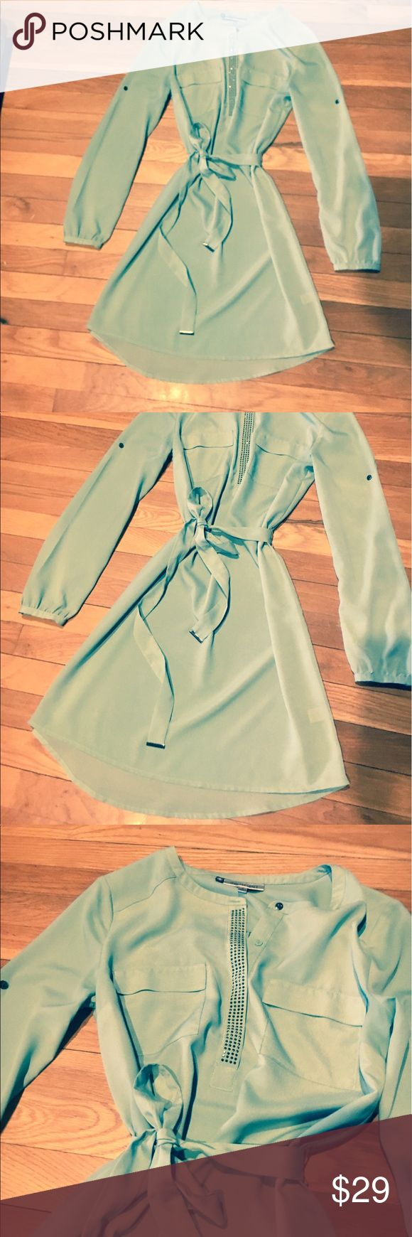 Nwot mint green dress Beautiful dress with jeweled detail in the front. Tie waist. The dress definitely needs a slip under it . But it's much prettier in person Jennifer Lopez Dresses Midi