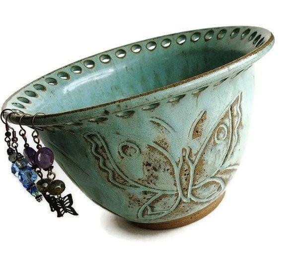 Could make with any type of bowl.  Drill holes? Metal could bend edges and mount to wall?? So many ways to make this :)