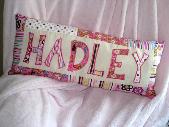 Custom appliqued name pillow. Can match bedding, bedroom decor, or nursery.