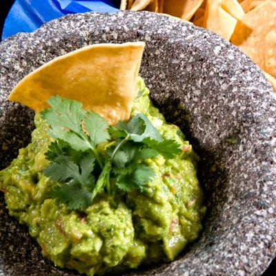 Richard Sandoval's Guacamole with Pomegranate     Mexico City native Richard Sandoval's 12 Mexican restaurants all have the go-to guacamoles on their menus. His standouts, though, are the crunchy spiced pumpkin seed and the sweet and crunchy variation flecked with pomegranate seeds.