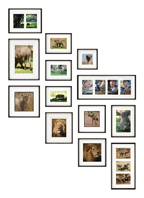 Stair Photo Wall Layout. Similar to our's, but I like the collage frames better here.