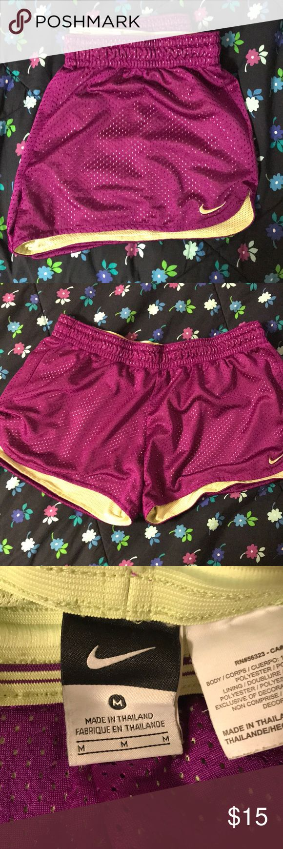 EUC Nike shorts size medium! Purple and lime green shorts! Size medium. Missing drawstring but the elastic is still tight and they stay up just fine. Nike Shorts
