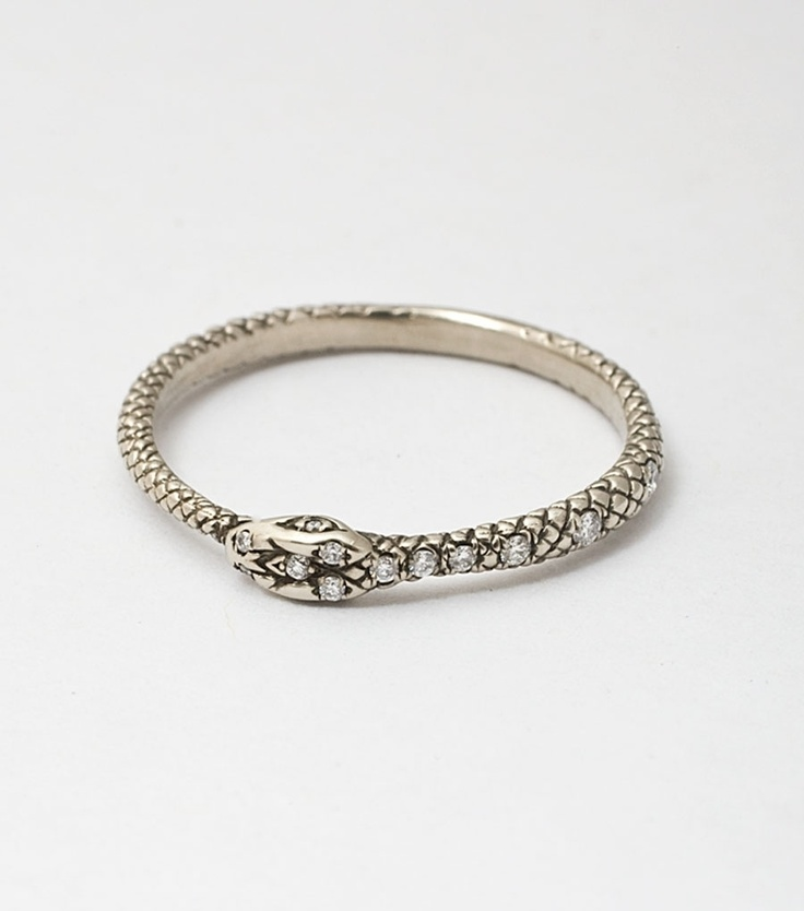 kinda weird but great meaning behind it .....The Ouroboros, Ancient symbol of eternity and rebirth. Queen Victoria wore a snake engagement ring from Prince Albert.  works for me :)