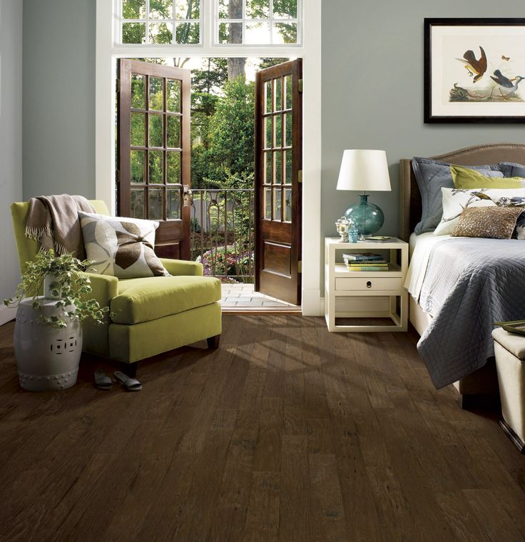 Light Wood Accent Wall: Light Grey Walls With Dark Wood Floor In Bedroom With