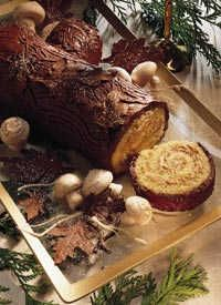 Bûche de Noël (I like the presentation photo but this recipe calls for  coffee in the filling. Cocoa powder can be used, but it takes about an hour for it to dissolve fully into the cream.)