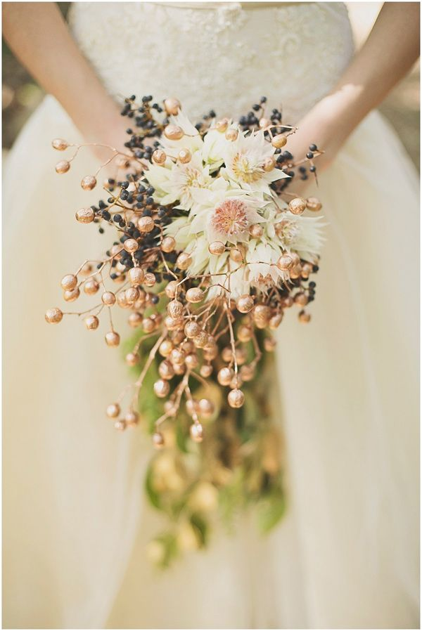 bouquet with copper details, photo by Ronel Kruger Photography http://ruffledblog.com/south-african-wine-estate-inspiration #weddingbouquet #flowers
