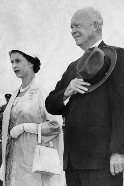 Queen Elizabeth and President Dwight D. Eisenhower stand at Dais as their national anthems are played at St. Hubert Royal Canadian Air Force station after their meeting for the official opening of the St. Lawrence Seaway on 26th June 1959. | AP Photo
