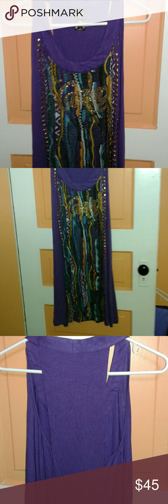 Ladies dress LADIES DRESS OR CAN BE WORN WITH LEGGINGS CUTE, PURPLE HAD GOLD STUDDS COMING DOWN BOTH SIDES HAS GOLD TURQUOISE BLACK, THE BACK IS OF COURSE SHOULDERLESS, IT COMES DOWN A LITTLE IN BACK , selling one in black to Coogi Dresses Midi
