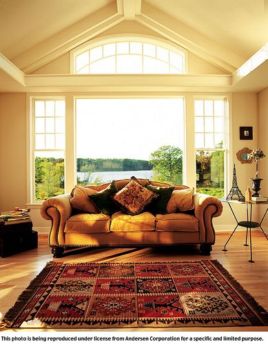 This wall of Andersen 400 Series windows is made up of a center picture window an Arch top window and two Tilt-Wash Double-hung Windows with a modified colonial grille pattern. All built with rich natural wood interiors with low-maintenance exteriors We are offering high quality cleaning products and services that help improve the health - http://naturalshields.com/
