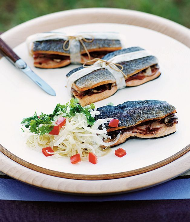 A Gourmet Traveller recipe for barbecue trout bundles with prosciutto and button mushrooms by Serge Dansereau of Sydney's Bathers' Pavilion.