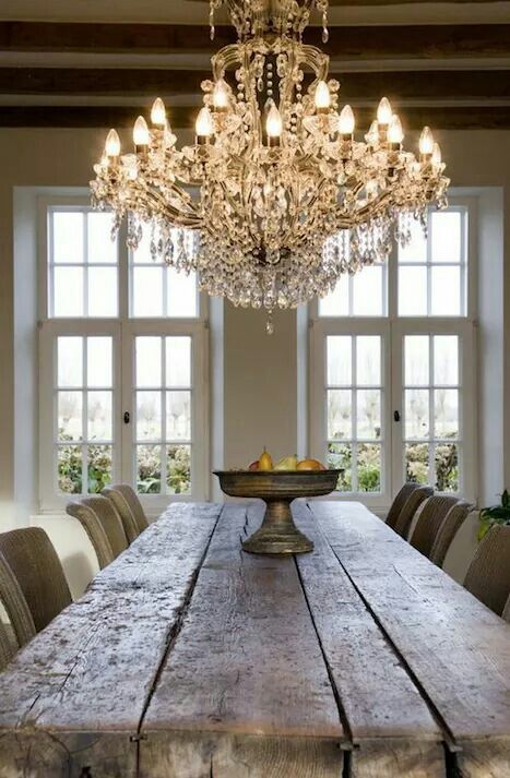 Rustic dinner table with gorgeous chandelier