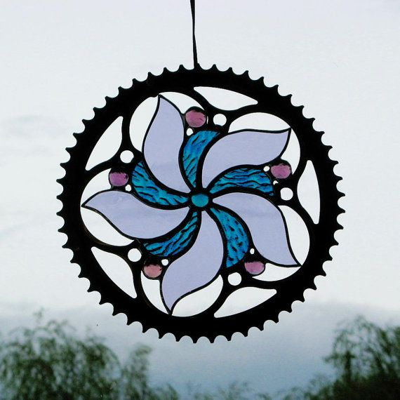 This is an interesting use of a bike sprocket.