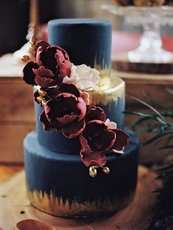 navy fondant cake with metallic gold and berry colored flowers / http://www.deerpearlflowers.com/burgundy-and-navy-wedding-color-ideas/2/