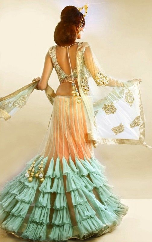 seafoam green lengha choli by Payal Singhal. I wouldn't wear a belly top to my wedding, but I like the general look of this and love the color.