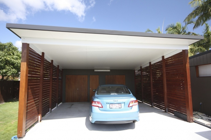 "Love it.  Make this wide-span, down the sloped driveway, with moveable slat screens _ that would be perfect.  Timber finishes, slick painted ceiling.  Slat screens (moveable would be better).  High opening at front for vehicle access. Styling is modern and ""spare"", well detailed and finished."