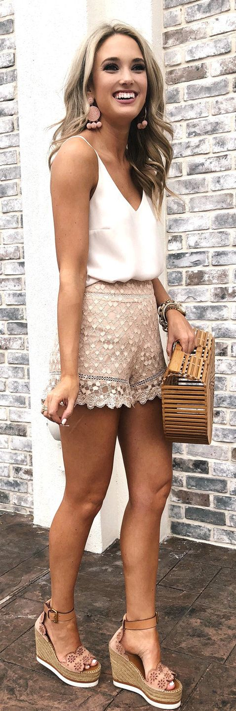 #spring #outfits woman in white deep v-neck spaghetti strap top and beige lace short shorts. Pic by @champagneandchanel